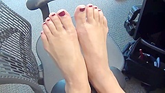 Blonde office worker shows off her beautiful feet