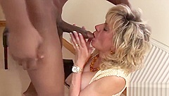 Cheating British mature lady Sonia flashes her heavy boobies