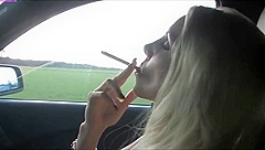 Danni smoking in her car