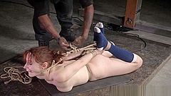 Submissive redhead tiedup and flogged by dom