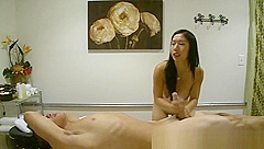 Pretty asian masseuse tugs client for cash
