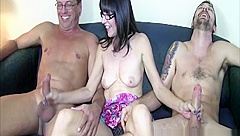 Busty cougar wanking off two hard cocks