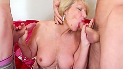 Hot British mother sucking and fucking two young boys