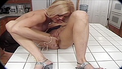Superb blondes fucking with strap-on