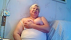 fat granny excitng her self and sucking her nipples part 1