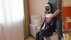 Intense breathplay in latex catsuit and gasmask