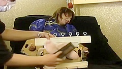 Japanese girl tickled in stocks