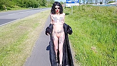 Slut Lucy Ravenblood walking nude at a public road