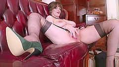 Big natural tits brunette masturbates in retro nylons garters high heels